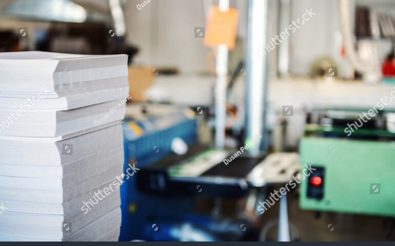 stock-photo-picture-of-printing-shop-interior-selective-focus-on-pile-of-sheets-1606012783